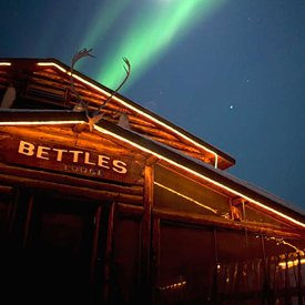 The historic Bettles Lodge with Aurora