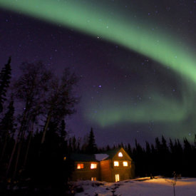 Northern Lights Shine Over A Taste of Alaska Lodge
