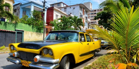 A classic car parked in the Vedado neighborhood of Havana